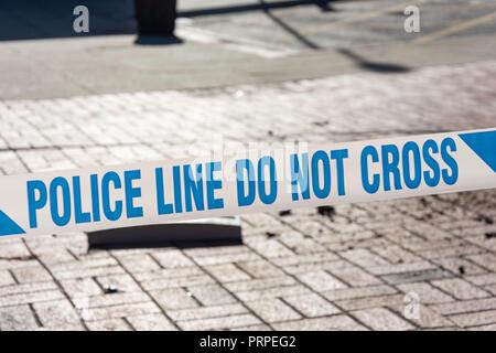 'Police line do not cross' tape, Reading, Berkshire, England, United Kingdom - Stock Photo
