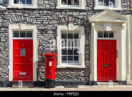 Period houses with red doors and pillar box, Horse Street, Chipping Sodbury, Gloucestershire, England, United Kingdom - Stock Photo