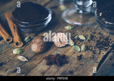 Spices for masala chai or chai latte. Nutmeg, cardamom, cinnamon and anis. Close up - Stock Photo