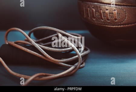 closeup photo of a skipping rope and a soccer ball - Stock Photo