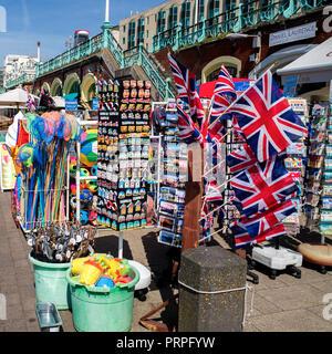 tourist shops under the promenade brighton beach - Stock Photo