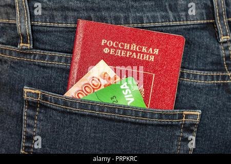 Samara, Russia - November 24, 2017: Russian passport, money and credit card Visa in back jeans pocket. Travel concept - Stock Photo
