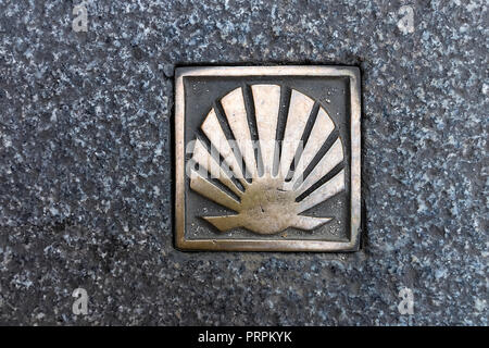 Symbol of the camino de santiago, plate found in the medieval city of Segovia, Spain - Stock Photo