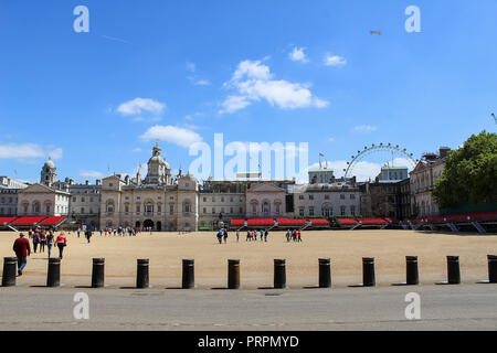 London, England, UK - MAY 26, 2015: Horse Guards Parade and London Eye, Old Admiralty Building and the Household Cavalry Museum. The area has been use - Stock Photo