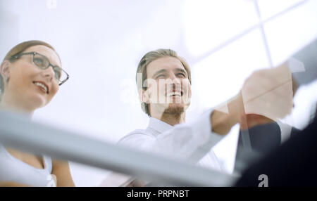 view from behind glass.handshake business people - Stock Photo