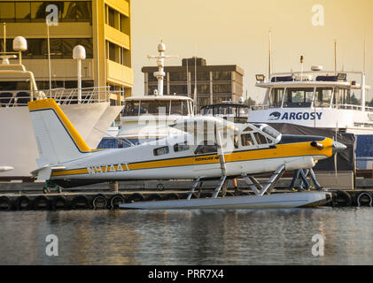 SEATTLE WA, USA - JUNE 2018: De Havilland Turbo Beaver float plane operated by Kenmore Air at the seaplane terminal in downtown Seattle at dawn. - Stock Photo