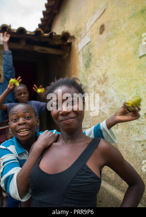 Angolan boys and girls in a village with mangoes, Huila Province, Caconda, Angola - Stock Photo