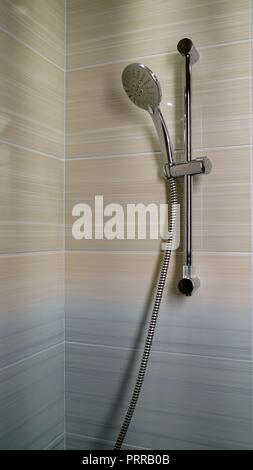 shower and shower holder. modern chrome shower attachment with thermostatic controller - Stock Photo