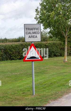 Road sign for traffic calmed area warning of speed humps - Stock Photo