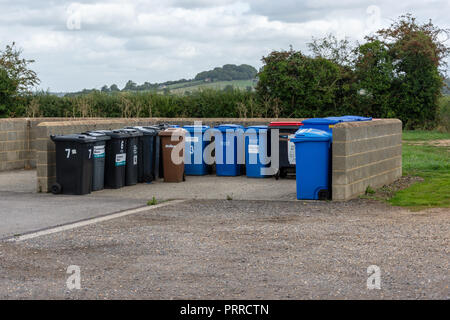 Small enclosure compound for rubbish bins and recycling bins separate from the units in a business park - Stock Photo
