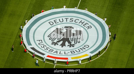 Young football players with rolled out banner with emblem German Football Association, Stadion Niederrhein, Oberhausen - Stock Photo