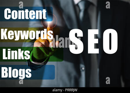 cropped view of professional seo manager in suit touching SEO ideas - Stock Photo
