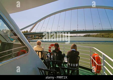 Sightseeing cruise on the river Guadalquivir and the Barqueta bridge, Seville, Region of Andalusia, Spain, Europe. - Stock Photo