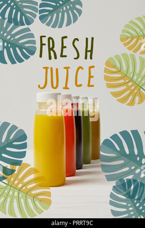 organic detox smoothies in bottles standing in row, fresh juice inscription - Stock Photo