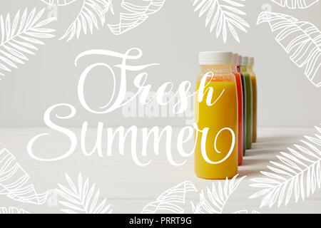 organic detox smoothies in bottles standing in row, fresh summer inscription - Stock Photo
