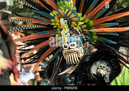 Mexican Indian Concheros dancers participate in the annual events celebrating the cities patron saint during the Feast of Saint Michael September 30, 2018 in San Miguel de Allende, Mexico. The festival is a four-day long event with processions, parades and a late night fireworks battle. - Stock Photo