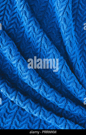 full frame of folded dark blue woolen fabric with pattern as backdrop - Stock Photo