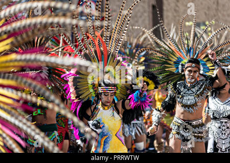 Mexican Indian Concheros dancers participate in the annual parade celebrating the cities patron saint during the Feast of Saint Michael September 30, 2018 in San Miguel de Allende, Mexico. The festival is a four-day long event with processions, parades and a late night fireworks battle. - Stock Photo