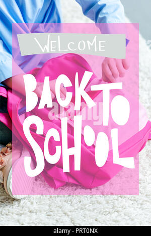 cropped shot of child packing pink school bag at home, welcome back to school concept - Stock Photo