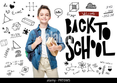 schoolboy holding backpack and books isolated on white, with icons and 'welcome back to school' lettering - Stock Photo