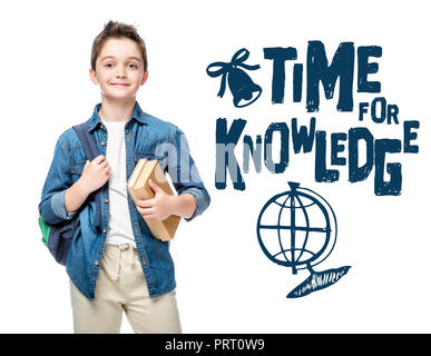 schoolboy holding backpack and books isolated on white, with globe and 'time to knowledge' lettering - Stock Photo