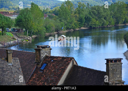 A traditional flat bottomed Scow, known locally as a Gabarre on the River Dordogne, France. Used for water transport in shallow waters - Stock Photo