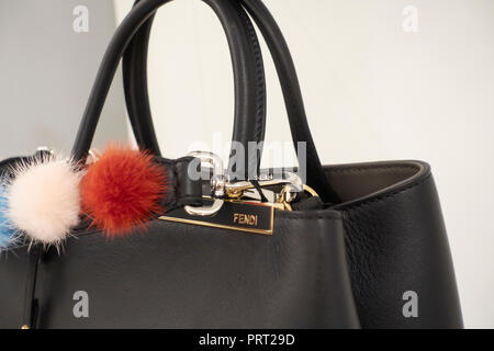 ae2cf4721ffe ... Fendi bags and shoes with pon pon on the shelves of a fashion store -  Stock