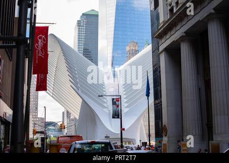 New York City, USA - August, 2018 : Futuristic form of The Oculus transportation hub at World Trade Center Subway Station in New York City, USA. Designed by Santiago Calatrava - Stock Photo