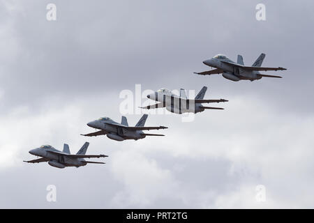 Four Royal Australian Air Force (RAAF) Boeing F/A-18F Super Hornet multirole fighter aircraft flying in formation. - Stock Photo