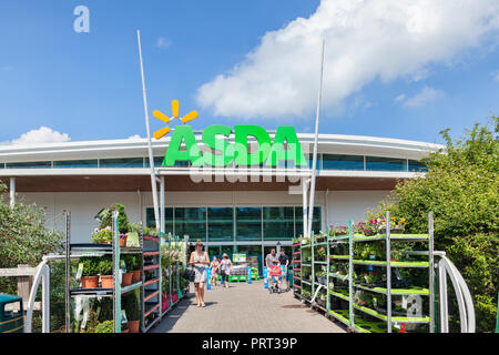 28 May 2018: Newton Abbot, Devon, UK - Asda supermarket entrance, with people leaving with their shopping. - Stock Photo