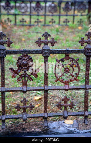 Rusted Iron Grill Around Grave at Brompton Cemetery in London UK - Stock Photo