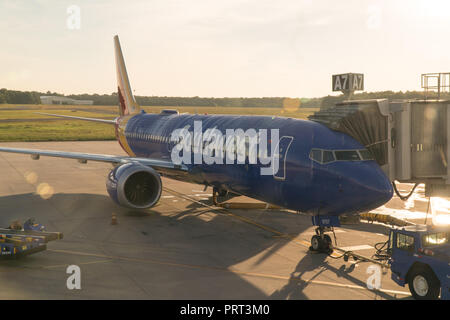 New York, USA - Circa 2018: Southwest airlines Boeing 737 airplane at terminal gate boaring passengers for early morning flight departure - Stock Photo