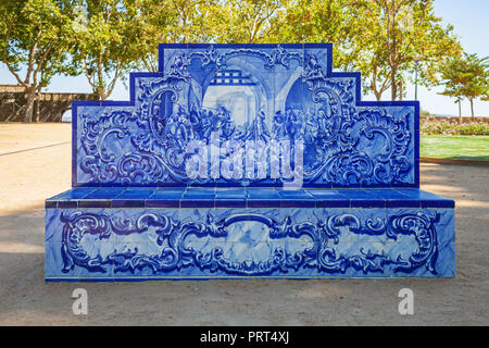 Santarem, Portugal. Park or garden bench covered in the typical and traditional Portuguese Azulejos or Blue tiles in Jardim das Portas do Sol garden - Stock Photo