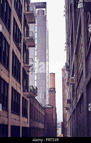 Retro toned old industrial buildings in New York on a rainy day, USA. - Stock Photo