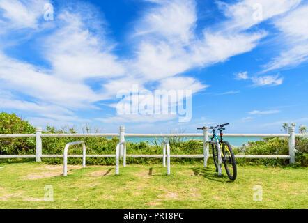 Bike in a cycle rack overlooking Trigg Beach, Trigg, Western Australia - Stock Photo