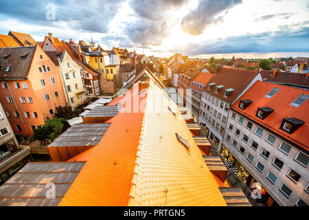 Top cityscape view on the old town with colorful buildings in Nurnberg during the sunset, Germany - Stock Photo