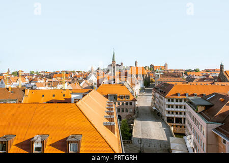 Top panoramic cityscape view on the old town with main central street in Nurnberg during the sunrise, Germany - Stock Photo