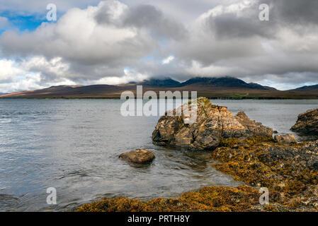 The Isle of Jura from Bunnahabhain on The Isle of Islay - Stock Photo