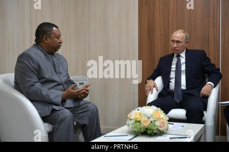 Russian President Vladimir Putin, right, meets with Secretary General of OPEC Mohammad Sanusi Barkindo prior to the Russian Energy Week forum on international energy efficiency and energy development at the Manezh Exhibition Center October 3, 2018 in Moscow, Russia. - Stock Photo