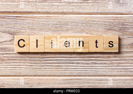 Clients word written on wood block. Clients text on table, concept. - Stock Photo