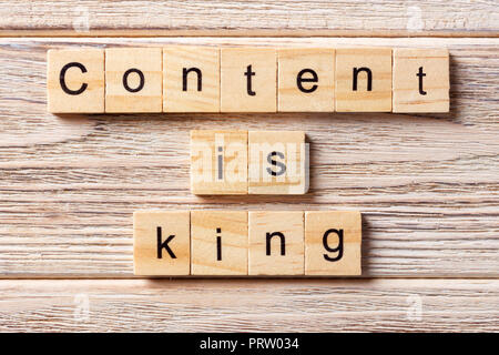 Content Is King word written on wood block. Content Is King text on table, concept. - Stock Photo