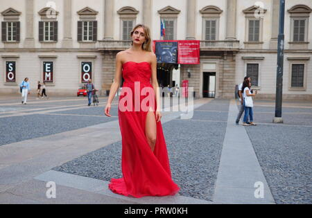 MILANO, Italy: September 21, 2018: Model posing for photographers in Duomo square after ACT 1 fashion show during MFW