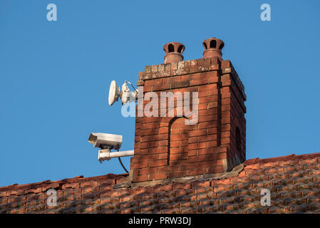 A remote controlled live traffic monitoring camera mounted on a chimney of a home facing the Pacific Highway at Gordon NSW, Australia - Stock Photo