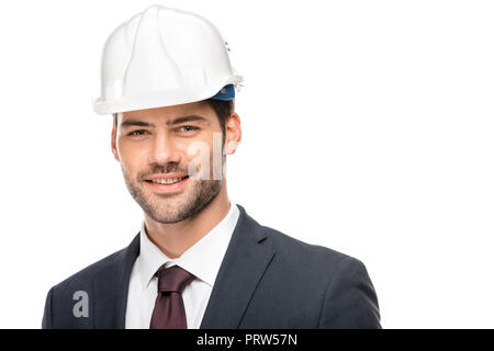 portrait of young male architect in hard hat looking at camera isolated on white - Stock Photo
