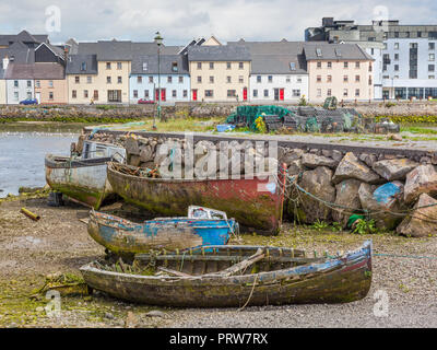 A boat graveyard next to River Corrib the Claddagh area of Galway in Ireland. - Stock Photo