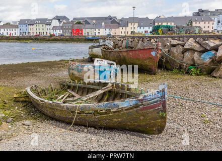 A boat graveyard in Next to Rover Corrib the Claddagh area of Galway in Ireland. - Stock Photo