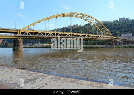 Pittsburgh, Pennsylvania - city in the United States. Fort Pitt bridge over Allegheny River. Double-decked bowstring arch bridge - Stock Photo