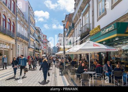 Shops and restaurant on Rua de Santa Catarina in the city centre, Porto, Portugal - Stock Photo