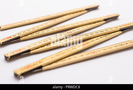 Wooden folding ruler isolated on a white background. - Stock Photo