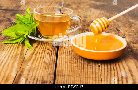 Cup of tea mint honey wooden background - Stock Photo